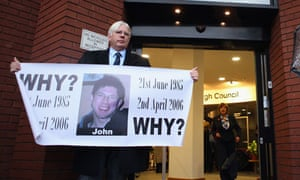 Frank Robinson holds a banner outside Stafford Civic Centre during the Mid Staffs inquiry