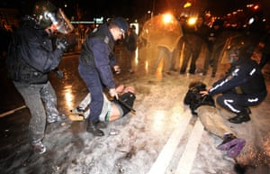Riot police clash with demonstrators during a protest against the government in downtown Sofia on February 19, 2013.