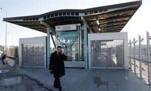 A man walks in front of a closed entrance of a suburban station during a 24-hour strike in Chalandri suburb north of Athens February 20, 2013.