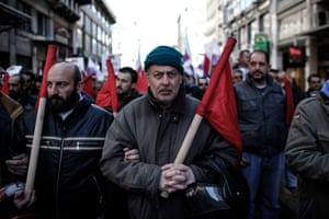 Members of a Greek Communist trade union demonstrate on February 20, 2013 in the center of Athens against austerity measures.