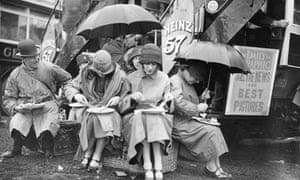 Epsom racegoers having lunch under umbrellas in the rain 1925