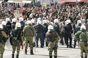Protesters shout slogans during a protest in the center of Athens.