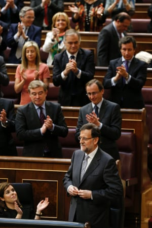 Spain's Prime Minister Mariano Rajoy (R) aknowledges applause after giving a speech during the state of the nation debate on February 20, 2013 at the Parliament in Madrid.