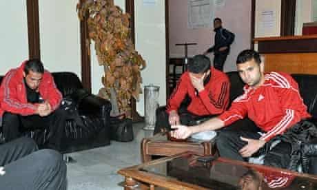 Syrian footballers from the al-Wathbah club after two mortars exploded next to a stadium in Damascus