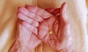 Medication in hands of elderly person
