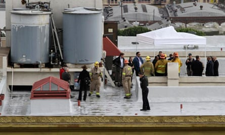 Authorities inspect a water tank atop the Cecil Hotel in downtown Los Angeles.