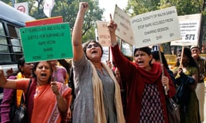 Activists from left-wing organisations shout slogans during a protest outside the Indian Parliament
