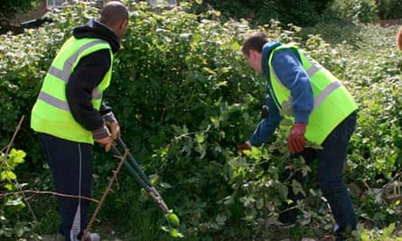 Young offenders doing community service overseen by police officers and probation service