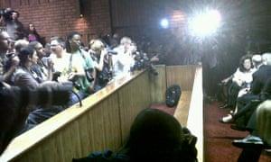 Media wait for Oscar Pistorius at Pretoria magistrates court on 22 February 2013