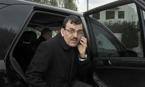 Tunisia's new prime minister Ali Laarayedh gets out of a car