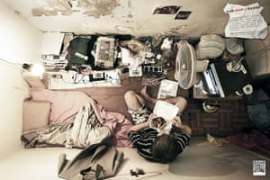 hong kong flats: A man eats dinner in his flat.