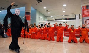 Iberia's workers dressed as prisoners protest at Terminal 1 of Barcelona's airport. Photograph: Reuters/Albert Gea (