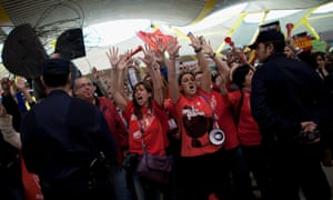 Iberia staff shout slogans during the protest at Barajas Airport  in Madrid. Photograph: Getty Images/ Pablo Blazquez Dominguez