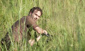 Rick takes cover in The Walking Dead.