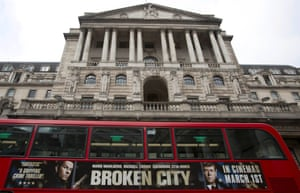 A bus passes the Bank of England in the City of London February 23, 2013.