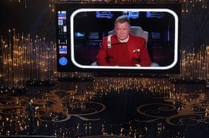 Oscar Ceremony 2013: Host Seth MacFarlane talks to actor William Shatner on the video screen