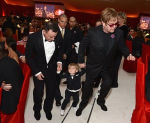 Oscars after party: David Furnish and Elton John bring Zachary along to the party