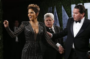 Oscars after party: Halle Berry is guided to her position in front of the cameras