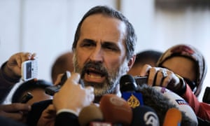The Syrian opposition lead Ahmed Moaz al-Khatib speaks to the press after a meeting at the Egyptian foreign ministry in Cairo on Monday.