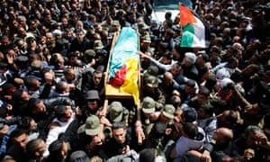 Palestinians carry the body of Arafat Jaradat during his funeral