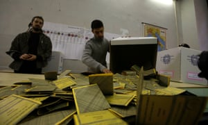 Ballots are being counted at a polling station in Rome, Monday, Feb. 25, 2013.