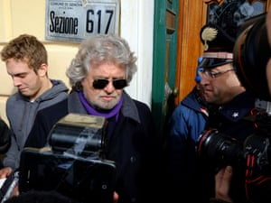 Comic-turned-politician Beppe Grillo, center, is photographed as he arrives at his polling station to cast his vote, in Genoa, Italy, Monday, Feb. 25, 2013.