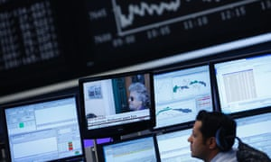 A trader looks at a TV screen showing news on Italy's 5-Star Movement leader and comedian Beppe Grillo, in front of the German share price index DAX board at the German stock exchange in Frankfurt February 26, 2013.