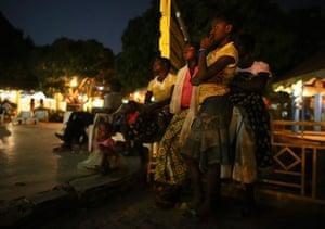 FTA: Nic Bothma: Girls watch an outdoor film screening