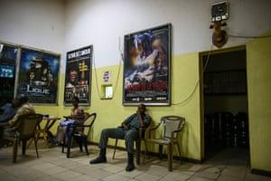 FTA: Nic Bothma: A soldier sits inside the lobby of Cinema Neerwaya