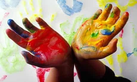 A pair of childrens hands with paint