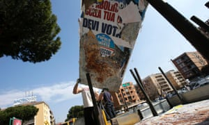 A worker removes electoral posters in Rome. Photograph: Reuters/Max Rossi