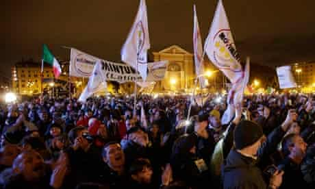 People react as Five Star Movement leader and comedian Beppe Grillo arrive during a rally in Rome