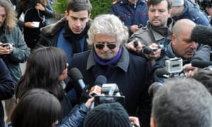 Beppe Grillo arrives at a polling station in Genoa  on Monday. Photograph: EPA/Riccardo Arata