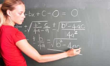 A young female student doing math at a chalkboard. Image shot 2007. Exact date unknown.