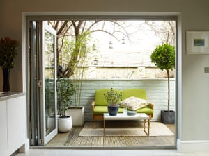 Homes - Economy Class: shot of outside terrace with green sofa