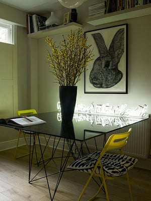 Homes - Economy Class: glass table with flowers and yellow chair