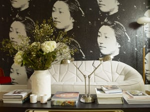Homes - Economy Class: cream chair with wallpaper of faces