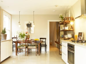 Homes - Economy Class: kitchen with cream walls and wooden table