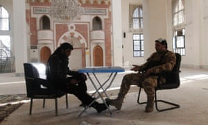 Members of the Free Syrian Army chat in a mosque near Nairab military airport in Aleppo on Tuesday.