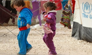 Syrian refugee children play outside their parents' tent at the Za'atari refugee camp in the Jordanian city of Mafraq on Monday.