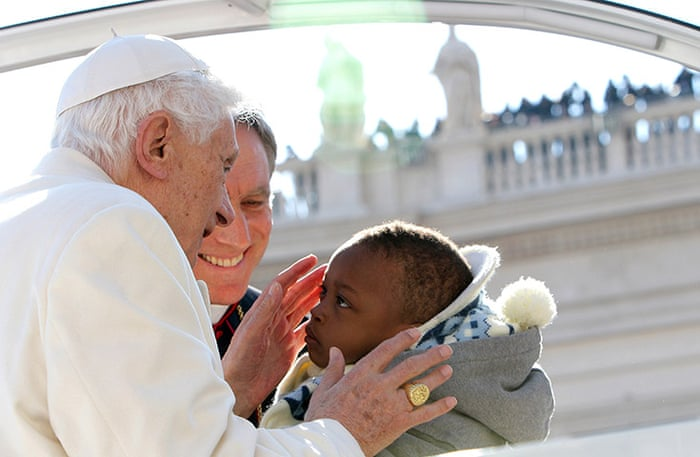 https://i.guim.co.uk/img/static/sys-images/Guardian/Pix/pictures/2013/2/27/1361976508689/Pope-Benedict-XVI-Holds-H-017.jpg?w=700&q=55&auto=format&usm=12&fit=max&s=a15eebaa1f2e231c3f37c8d65cb18713