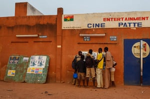 FTA: Nic Bothma: Schoolboys look at film posters outside the open-air Cinema Patte d'Oie
