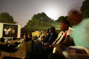 FTA: Nic Bothma: Festivalgoers watch an open-air film screening in Ouagadougou