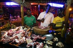 FTA: Nic Bothma: A chef chops meat at a roadside restaurant