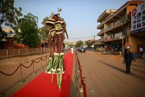 FTA: Nic Bothma: Performers rehearsing on the red carpet outside Cinema Burkina