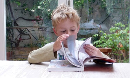 Six year old boy reading a book
