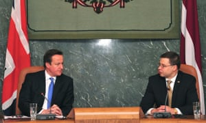 Latvian Prime Minister Valdis Dombrovskis  and his British counterpart David Cameron attend a meeting in Riga.