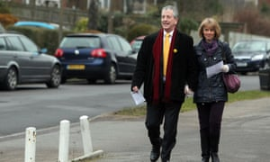 Liberal Democrat candidate Mike Thornton arrives with his wife Peta at a polling station to cast his vote in the by-election in Eastleigh.