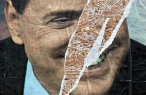 A ripped election poster shows a smiling Silvio Berlusconi.
