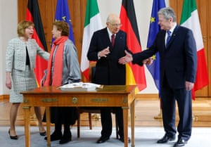 Italy's President Giorgio Napolitano (second from the right) and his wife Clio Bittoni (next to him) greet German President Joachim Gauck and his partner Daniela Schadt in Berlin earlier today.